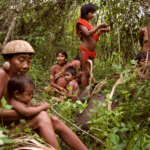 Yanomami women and children rest in a forest garden, Brazil.