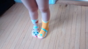 My daughter donning her dog and cat pals socks